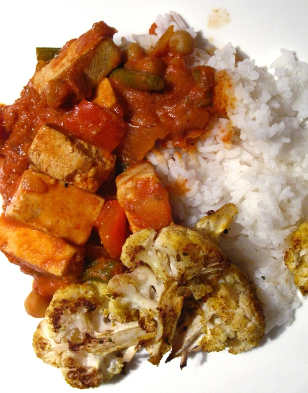 Butter tofu served with rice and roasted cauliflower.